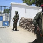 An AU peacekeeper from Uganda and a Somali government soldier guard the presidential palace in Mogadishu