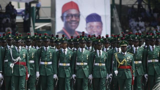 Nigeria Soldiers parade during the inauguration of the new Nigerian President, Muhammadu Buhari, in Abuja , Nigeria, Friday, May 29, 2015. Nigerians celebrated their newly reinforced democracy Friday, dancing and singing songs and praises at the inauguration of Muhammadu Buhari, the first candidate to beat a sitting president at the polls. (AP Photo/Sunday Alamba)
