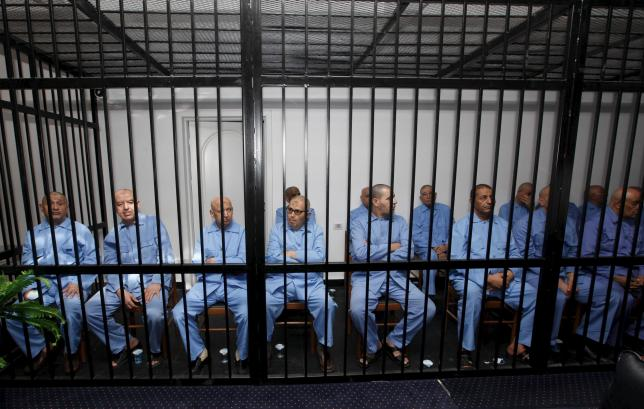 Former Gaddafi regime's officials sit behind bars during a verdict hearing at a courtroom in Tripoli, Libya July 28, 2015. REUTERS/Ismail Zitouny