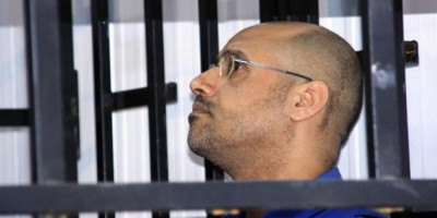 Saif al-Islam Gaddafi, son of late Libyan leader Muammar Gaddafi, attends a hearing behind bars in a courtroom in Zintan May 25, 2014. REUTERS/Stringer