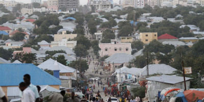 People walk along a street in Mogadishu