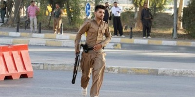 A member of peshmerga forces runs at the site of an attack by Islamic State militants in Kirkuk