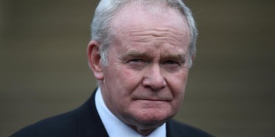 FILE PHOTO: Northern Ireland's Deputy First Minister Martin McGuinness pauses before speaking to media at Stormont Castle as he arrives to greet Colombia's President Juan Manuel Santos who is on a state visit to Belfast, Northern Ireland